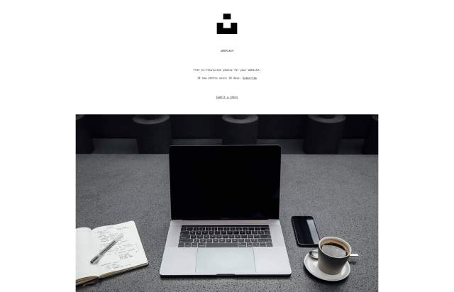 Screenshot of the homepage of the minimal website Unsplash, published on The Gallery on the 2019-05-31 and tagged with the tags old school,photos,resources,tumblr,free,center aligned,single column