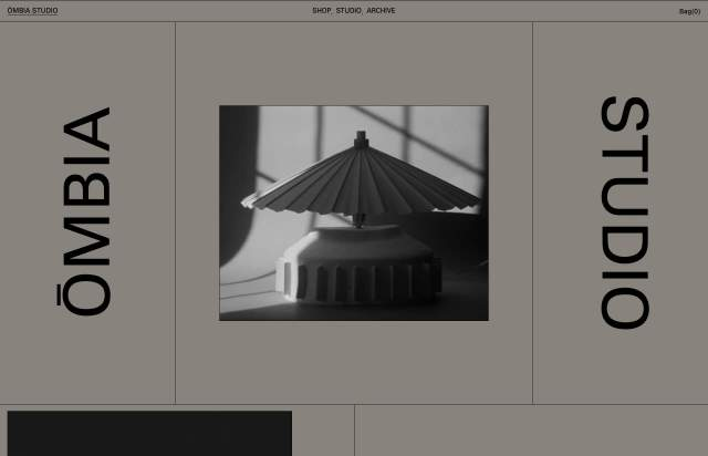 Screenshot of the homepage of the minimal website Ombia, published on The Gallery on the 2021-04-27 and tagged with the tags portfolio, grid, dark